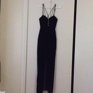 Black velvet slit dress.